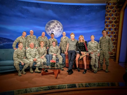 Members of the U.S.A.F. Full Spectrum pose with late-night talk show host Conan O'Brien and guest vocalist Grace Potter, prior to performing a special Veteran's tribute on Nov 10, 2016.