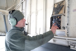 Senior Airman Jaramie York, 459th Aircraft Maintenance Squadron maintainer, operates a single point refuel panel on a KC-135R Stratotanker at Joint Base Andrews, Md., Dec. 13, 2016. As an aircraft structural maintainer, York's responsibilities range from fabricating replacement aircraft structural components to refueling aircraft to marshaling departing aircraft onto the runway. (U.S. Air Force photo by Staff Sgt. Joe Yanik)