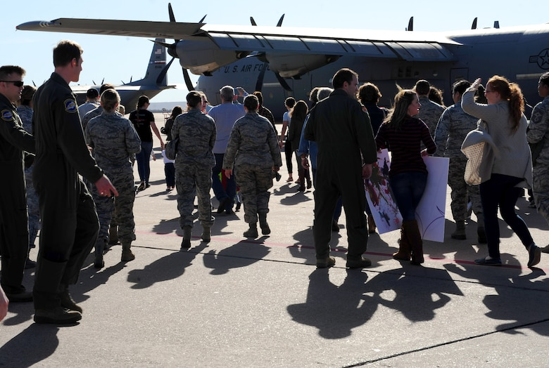 Dyess Airmen, friends and families rush to a C-130J Super Hercules to greet returning deployers at Dyess Air Force Base, Texas, Jan. 20, 2017. More than 50 Airmen and four C-130s returned to Dyess after supporting operations in Africa and Germany for four months.