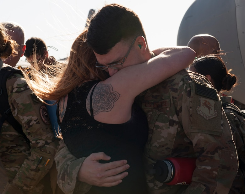 U.S. Air Force Airman 1st Class Edward Koren, 317th Aircraft Maintenance Squadron communication navigation maintenance specialist, embraces a loved one at Dyess Air Force Base, Texas, Jan. 20, 2017. Dyess aircrews have a rotational deployment schedule, which provides combat-delivery capabilities through tactical airlift and airdrop operations as well as supporting global humanitarian efforts.