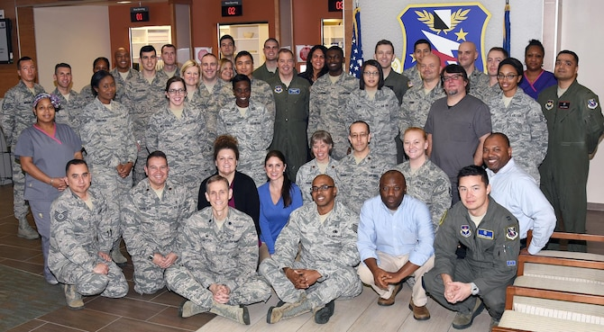 Members from the 14th Medical Group Biomedical Sciences Corps organizations pause for a photo to celebrate BSC Week Jan. 23, 2017, at Columbus Air Force Base, Mississippi. BSC Week ran from Jan. 23-27 and highlighted their 52nd anniversary. The BSC contains the aerospace and operational physiology, biomedical laboratory, bioenvironmental engineering, optometry, pharmacy, physical therapy, physician assistant, public health, psychology and social work. (U.S. Air Force photo by Sharon Ybarra)
