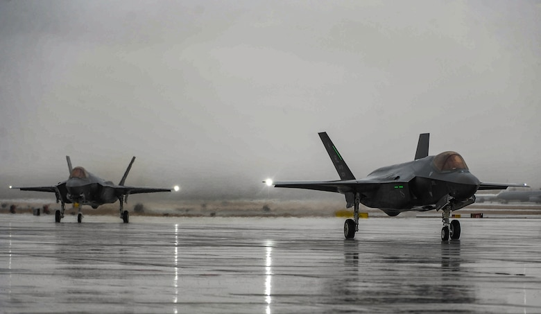 Two F-35A Lightning IIs assigned to Hill Air Force Base, Utah, taxi after landing at Nellis Air Force Base, Nev., to participate in Red Flag 17-1, Jan. 21, 2017. Red Flag is a realistic combat exercise involving U.S. and allied air forces conducting training operation on the 15,000 square mile Nevada Test and Training Range. (U.S. Air Force photo by Airman 1st Class Kevin Tanenbaum/Released)