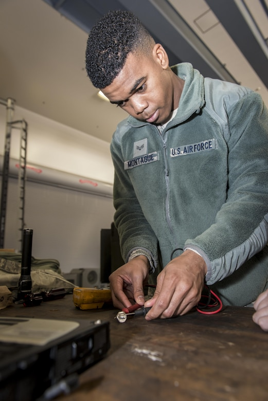 U.S. Air Force Senior Airman Shaquille Montague, a firefighter with the 35th Civil Engineer Squadron, charges a diode for a M32A-60A gas turbine generator during Misawa's first-ever career field exchange and shadow program at Misawa Air Base, Japan, Jan. 26, 2017. The generator is a 35th Maintenance Squadron aerospace ground equipment flight asset used to troubleshoot F-16 Fighting Falcons prior to takeoff. Montague joined five other Airmen who took part in Misawa's first-ever career field exchange and shadow program. (U.S. Air Force photo by Staff Sgt. Benjamin W. Stratton)