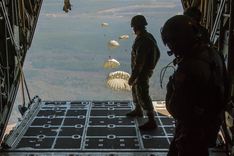 U.S. Soldiers assigned to the 421st Quartermaster Company, U.S. Army Reserve, perform a static-line jump out of a C-130 Hercules over Sylvania, Ga., on Jan. 10, 2017. The jump was part of joint training involving aircraft and aircrews from the Kentucky Air National Guard and Missouri Air National Guard. (U.S. Air National Guard photo by Senior Airman Sheldon Thompson)