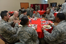 U.S. Airmen attending a spiritual fitness luncheon share a meal together, Jan. 26, 2017, at Incirlik Air Base, Turkey. Guests were treated to Turkish food for lunch including salads, chicken wings and baklava. (U.S. Air Force photo by Senior Airman John Nieves Camacho)