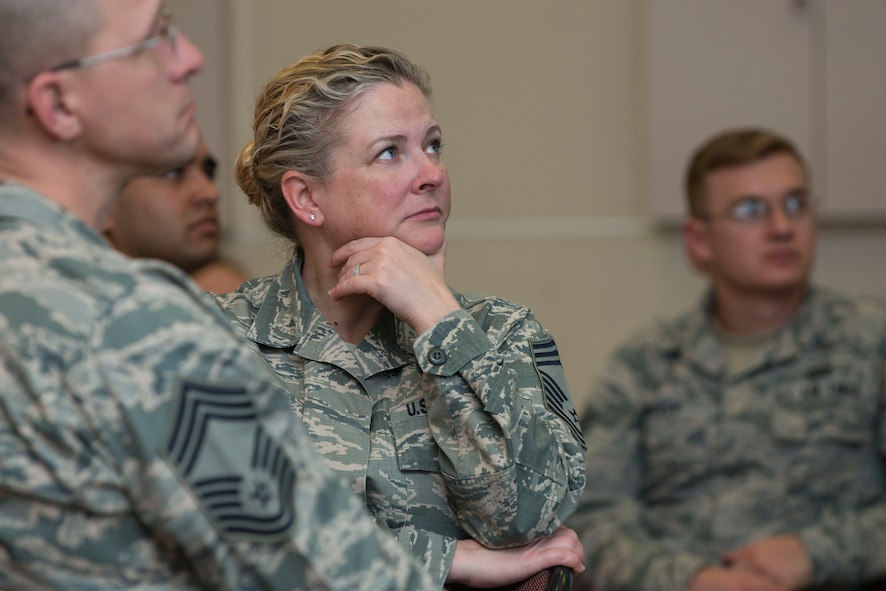 Chief Master Sgt. Stephanie Cates, 447th Air Expeditionary Group superintendent, listens as Chaplain (Maj. Gen.) Dondi Costin, Air Force chief of chaplains, speaks during a spiritual fitness luncheon, Jan. 26, 2017, at Incirlik Air Base, Turkey. More than 100 Airmen gathered at the community center for the event. (U.S. Air Force photo by Senior Airman John Nieves Camacho)