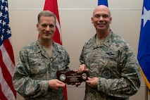 Col. Michael Manion (right), 39th Air Base Wing vice commander, presents a plaque to Chaplain (Maj. Gen.) Dondi Costin, Air Force chief of chaplains, during a spiritual fitness luncheon, Jan. 26, 2017, at Incirlik Air Base, Turkey. As chief of chaplains, Costin creates guidance and offers advice on all matters involving religious and moral welfare for Air Force personnel, as well as establishing programs to meet the religious needs of Airmen and their dependents. (U.S. Air Force photo by Senior Airman John Nieves Camacho)