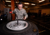 U.S. Air Force Senior Airman Tyler Hyatt, 100th Maintenance Squadron aero repair journeyman, collects and inspects bolts, nuts and washers from a wheel and tire assembly Jan. 20, 2017, on RAF Mildenhall, England. There are more than 50 nuts, bolts and washers joining the assembly together. (U.S. Air Force photo by Senior Airman Christine Halan)