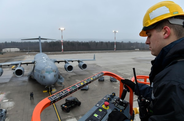 Staff Sgt. Zachary Rodewig, 721st Aircraft Maintenance Squadron C-5 Galaxy crew chief, operates a high-reach maintenance platform at Ramstein Air Base, Germany, Jan. 24, 2017. Rodewig and other 721st AMXS mobility Airmen replaced a panel on a C-17 Globemaster III aircraft. The 721st AMXS inspects, repairs, and services all C-17 and C-5 Galaxy aircraft that come through Ramstein. (U.S. Air Force photo by Senior Airman Tryphena Mayhugh)