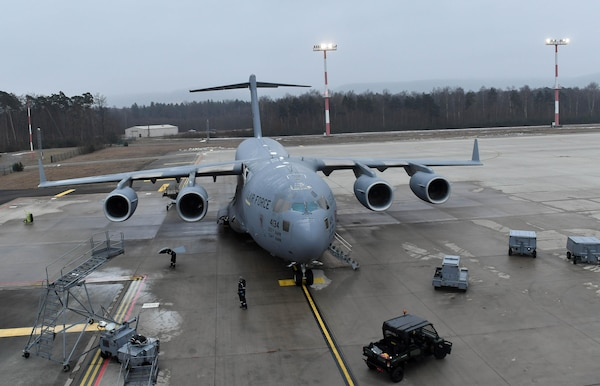 Airmen assigned to the 721st Aircraft Maintenance Squadron work on a C-17 Globemaster III at Ramstein Air Base, Germany, Jan. 24, 2017. The Airmen replaced a panel underneath one of the wings of the aircraft. In one weekend, the 721st AMXS are responsible for more missions than all the other squadrons in the European and Pacific Commands handle in a month combined. (U.S. Air Force photo by Senior Airman Tryphena Mayhugh)