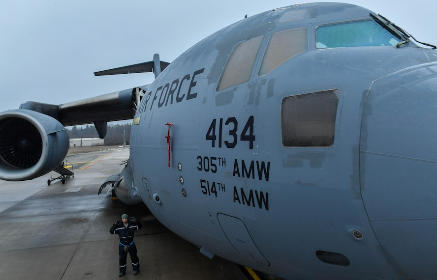 Tech. Sgt. Joey Whatley, 721st Aircraft Maintenance Squadron aircraft propulsion technician, marshals a high-reach maintenance platform up to a C-17 Globemaster III at Ramstein Air Base, Germany, Jan. 24, 2017. On average, the 721st AMXS inspects, services, and repairs 30 aircraft in a single day. The 721st AMXS is part of Air Mobility Command's 521st Air Mobility Operations Wing. (U.S. Air Force photo by Senior Airman Tryphena Mayhugh)