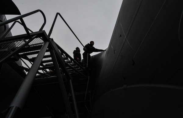 Staff Sgt. Keith Varden, 721st Aircraft Maintenance Squadron C-17 Globemaster III crew chief, places a panel onto a C-17 at Ramstein Air Base, Germany, Jan. 24, 2017. The 721st AMXS inspects, repairs, and services all C-17 and C-5 Galaxy aircraft that come through Ramstein. The 721st AMXS is part of Air Mobility Command's 521st Air Mobility Operations Wing. (U.S. Air Force photo by Senior Airman Tryphena Mayhugh)