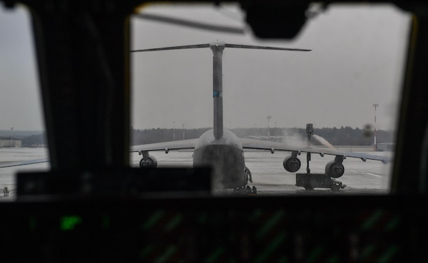 U.S. Air Force Reserve Airmen working with the 721st Aircraft Maintenance Squadron spray propylene glycol onto a C-17 Globemaster III at Ramstein Air Base, Germany, Jan. 24, 2017. The spray was used to deice the aircraft before it departed. In one weekend, the 721st AMXS is responsible for more missions than all the other squadrons in the European and Pacific handle in a month combined. (U.S. Air Force photo by Senior Airman Tryphena Mayhugh)