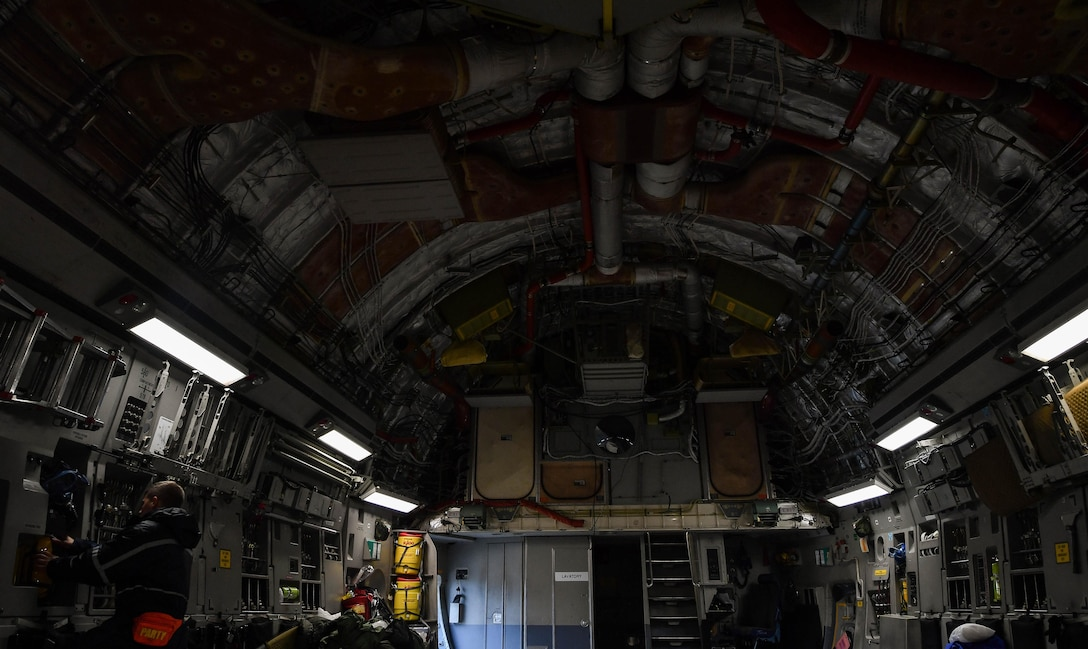 Staff Sgt. Zachary Rodewig, 721st Aircraft Maintenance Squadron C-5 Galaxy crew chief, inspects a C-17 Globemaster III before it can be cleared for departure at Ramstein Air Base, Germany, Jan. 24, 2017. All Airmen within the 721st AMXS must be qualified on C-17 Globemaster III and C-5 aircraft as they are responsible for inspecting, repairing, and servicing all C-17 and C-5 aircraft that come through Ramstein. (U.S. Air Force photo by Senior Airman Tryphena Mayhugh)
