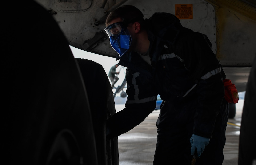 Staff Sgt. Zachary Rodewig, 721st Aircraft Maintenance Squadron C-5 Galaxy crew chief, removes the cap on a tire of a C-5 at Ramstein Air Base, Germany, Jan. 4, 2017. Rodewig checked the tire pressure of all 28 tires on the plane. The 721st AMXS inspects, repairs, and services all C-17 and C-5 Galaxy aircraft that come through Ramstein. (U.S. Air Force photo by Senior Airman Tryphena Mayhugh)