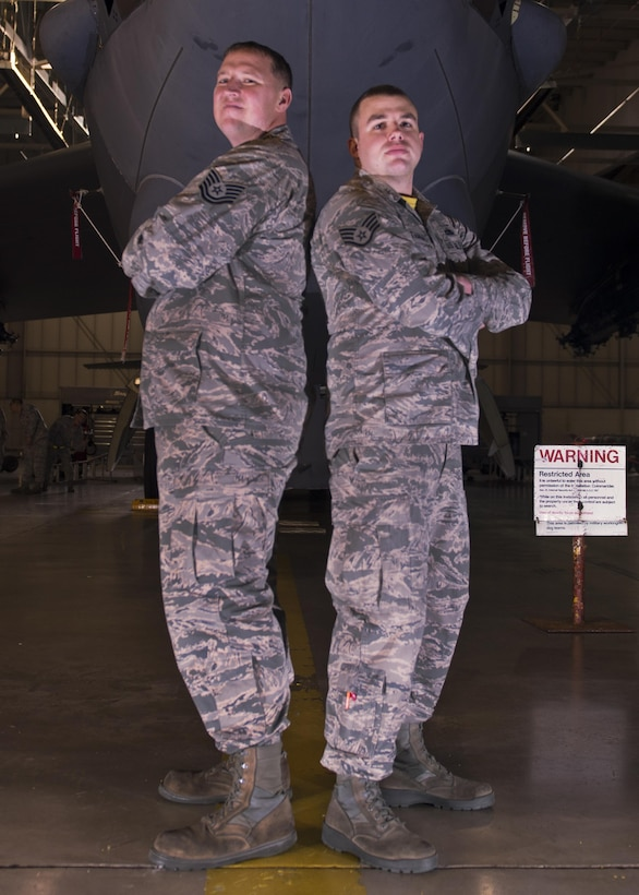 Staff Sgt. Eric Hathaway, 69th Aircraft Maintenance Unit weapons load crew chief, and Tech. Sgt. Fred Manternach, 23rd AMU weapons load crew chief, participate in the 5th Bomb Wing Load Crew of the Quarter competition in Dock 7 at Minot Air Force Base, N.D., Jan. 20, 2017. Two weapons load crews representing the 23rd AMU and the 69th AMU were timed on their ability to load two inert munitions onto a B-52H Stratofortress. (U.S. Air Force photo/Airman 1st Class Alyssa M. Akers)