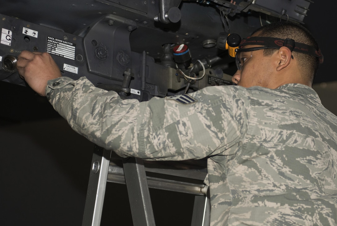Senior Airman Philip Johnson, 69th Aircraft Maintenance Unit weapons load crew member, prepares a B-52H Stratofortress bomb rack during the 5th Bomb Wing Load Crew of the Quarter competition in Dock 7 at Minot Air Force Base, N.D., Jan. 20, 2017. Representative weapons load crews were made up of teams of four for the competition. (U.S. Air Force photo/Airman 1st Class Alyssa M. Akers)