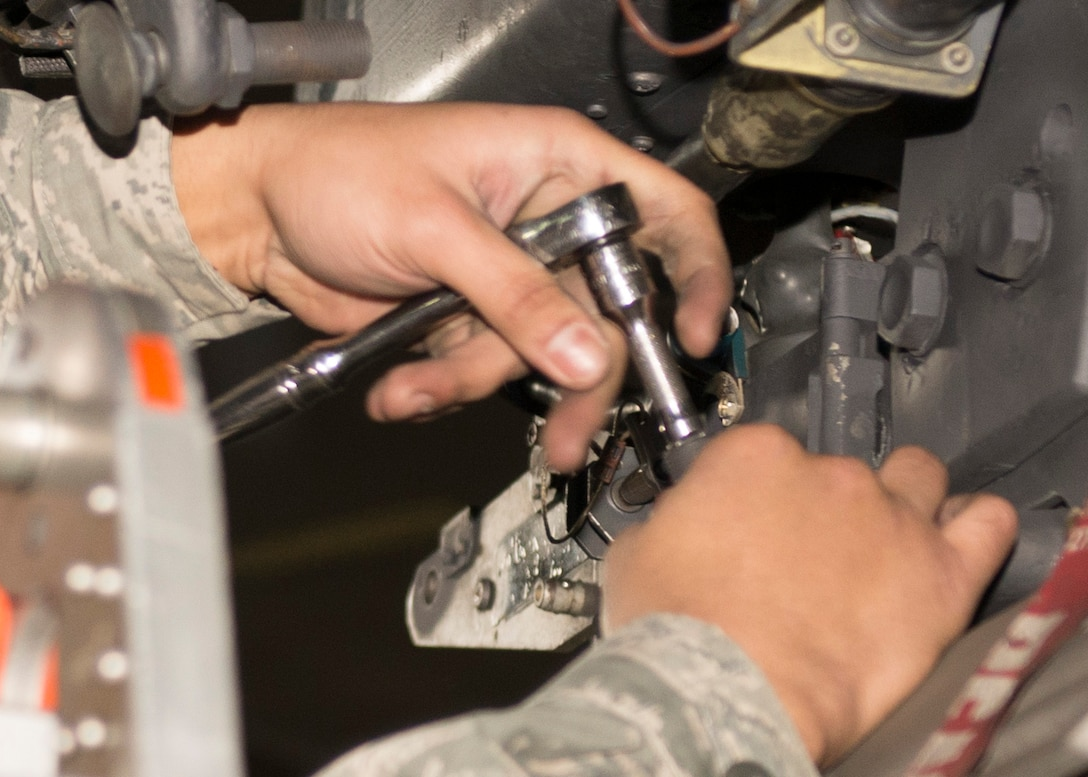 Senior Airman Philip Johnson, 69th Aircraft Maintenance Unit weapons load crew member, works on a B-52H Stratofortress during the 5th Bomb Wing Load Crew of the Quarter competition in Dock 7 at Minot Air Force Base, N.D., Jan. 20, 2017. The 23rd and 69th AMU competed in a timed bomb load as a part of the Load Crew of the Quarter competition. (U.S. Air Force photo/Airman 1st Class Alyssa M. Akers)
