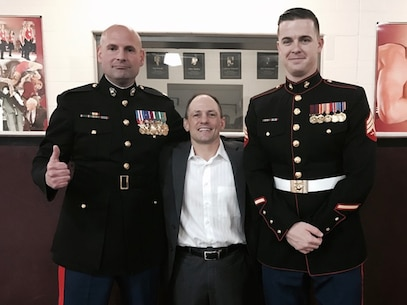Maj. Ryan Cohen, the commanding officer for Recruiting Station Oklahoma City, and Sgt. Riley Saunders, a canvassing recruiter for Recruiting Substation Oklahoma City North,  pose for a photo with University of Oklahoma Wrestling Head Coach Lou Rosselli before their match against West Virginia, Jan. 22, 2017, at McCasland Field House, Norman, Okla. Cohen gave a motivational speech to the 14th-ranked Sooners wrestling team before they went on to defeat their opponent 37 to 6.