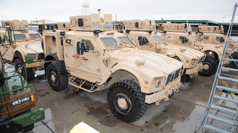 Mine Resistant Ambush Protected All Terrain Vehicles have finished their upgrades, armor improvements and await road testing at Production Plant Barstow, Marine Depot Maintenance Command, on the Yermo Annex of Marine Corps Logistics Base Barstow, California, Jan. 12, 2017. The specialized vehicles are favored for troop transporting in the mountainous country of Afghanistan. The turret atop the M-ATV marks this as a Marine Corps variant of the MRAP.