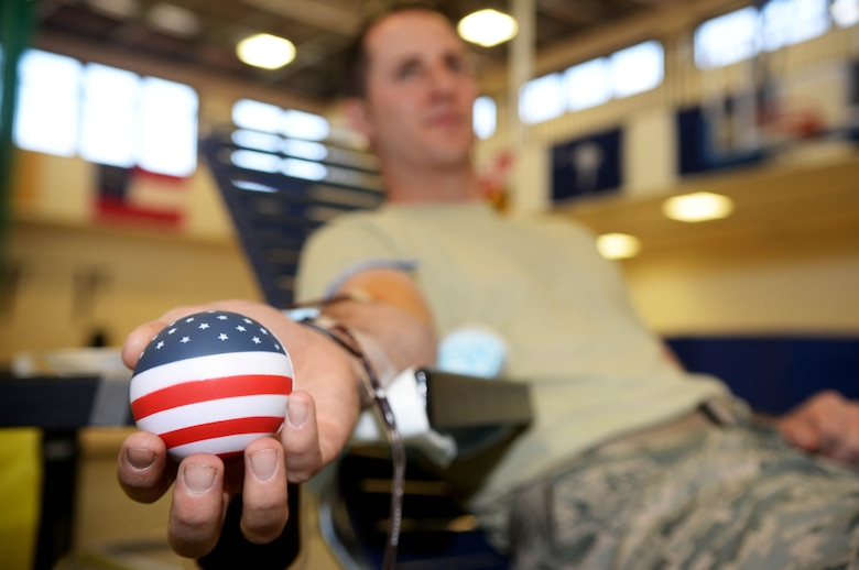 A Team Mildenhall Airman donates blood at a blood drive May 4, 2016, on RAF Mildenhall, England. The blood drive was held by the Armed Services Blood Program. (U.S. Air Force photo by Airman 1st Class Tenley Long)