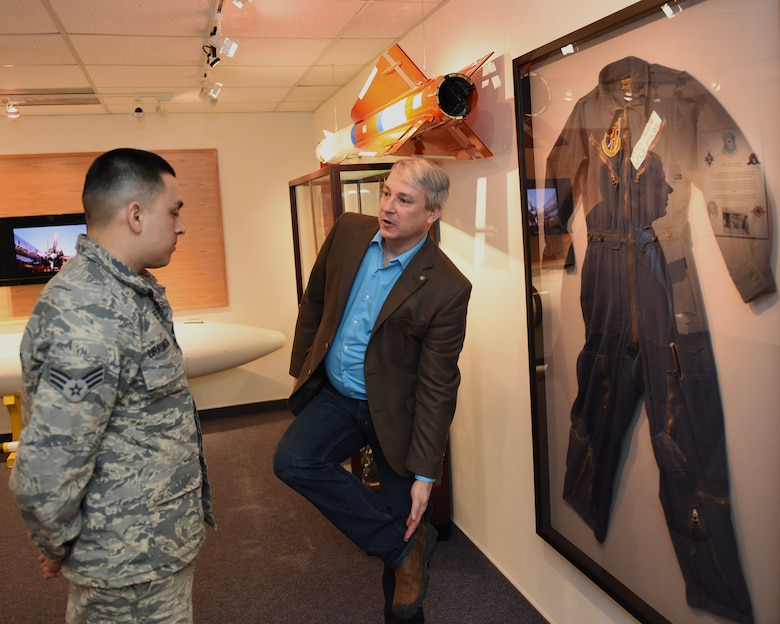 Senior Airman Valverde Urrunaga, 341st Civil Engineer Squadron Water & Fuels Systems Maintenance gets a history lesson about the missileer uniforms from Rob Turnbow, the Malmstrom Historic Exhibit and Air Park curator, Jan. 26, 2017 at Malmstrom Air Force Base, Mont.  The museum contains more than 400 items on display that depicts the history of Malmstrom Air Force Base and the Minuteman program.  (U.S. Air Force photo/Jason Heavner)