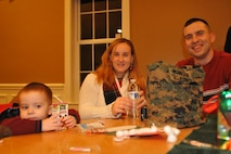 Ayden (left), Melissa and Staff Sgt. James McGregor pose for a photo during the 2012 Exceptional Family Member Program Christmas Party at the Lincoln Military Housing's Community Center. The EFMP is a mandatory Department of Defense support program for military family members who have special medical and/or educational requirements. The program is designed to help coordinate permanent change of station assignments to locations where family members with a diagnosed physical, psychological or educational need have access to required care. James McGregor currently serves as the Regional Network Operations and Security Center Watch Chief for Marine Corps Forces Reserve.