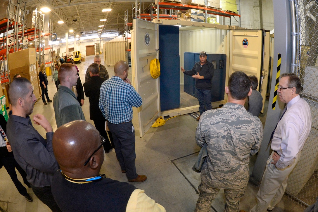 Kim Baird, DLA Distribution Hill, Utah shelter maintenance supervisor, describes a new support structure used for maintaining missile launch facilities and control centers to customers Jan. 25, 2017, at Hill Air Force Base, Utah. (U.S. Air Force photo by Todd Cromar)