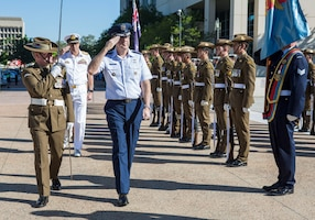 U.S. Air Force Gen. John E. Hyten (center), commander of U.S. Strategic Command (USSTRATCOM), returns a salute to Australian Defence forces (ADF) with Royal Australian Navy Vice Adm. Ray Griggs (background, center left), vice chief of the ADF at Russell Offices, Canberra, Jan. 17, 2017. The ADF honor guard was present for the formal arrival during the USSTRATCOM-Australia Defence Organization bi-lateral engagement. The visit aligns with USSTRATCOM's priority to enhance interoperability between U.S. and Australian forces; expand cooperation in space, cyberspace, intelligence and missile defense; and identify future opportunities for cooperation and engagement. One of nine DoD unified combatant commands, USSTRATCOM has global strategic missions assigned through the Unified Command Plan that include strategic deterrence; space operations; cyberspace operations; joint electronic warfare; global strike; missile defense; intelligence, surveillance and reconnaissance; and analysis and targeting.