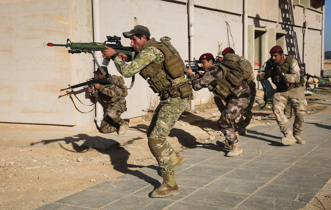 Iraqi soldiers from 7th Iraqi Army Division maneuver as a squad during the platoon assault movement portion of their culminating training at Al Asad Air Base, Iraq, Jan. 15, 2017. Training at building partner capacity sites is an integral part of Combined Joint Task Force – Operation Inherent Resolve's effort to train Iraqi security forces personnel. CJTF-OIR is the global Coalition to defeat ISIL in Iraq and Syria. (U.S. Army photo by Sgt. Lisa Soy)