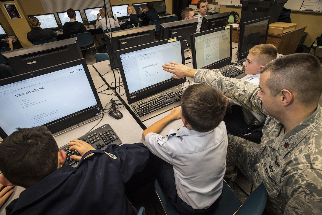 Maj. Trevor Cook, ICBM Systems Directorate Cyber Division deputy chief, mentors cadets at the Utah Military Academy, Riverdale, Utah, Jan. 5. UMA is one of over 3,000 teams participating in CyberPatriot IX. The cybersecurity competition kicked off in October 2016 and the national finals will take place in March. (U.S. Air Force photo by Paul Holcomb)