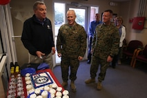 From left to right David Collins with the assistance of Brig. Gen. Thomas Weidley and Brig. Gen. David Maxwell cut the cake for the Navy-Marine Corps Relief Society's 113th birthday at Marine Corps Base Camp Lejeune's Navy-Marine Corps Relief Society, Jan. 23. The society provides financial and educational assistance for active duty, retired service members and their dependents. David Collins is the executive vice president for the Navy-Marine Corp Relief Society. Weidley is the commanding general for Marine Corps Installations East – Marine Corps Base Camp Lejeune. Maxwell is the commanding general for 2nd Marine Logistics Group, 2nd Marine Expeditionary Force. (U.S. Marine Corps photo by Lance Cpl. Tavairus Hernandez)