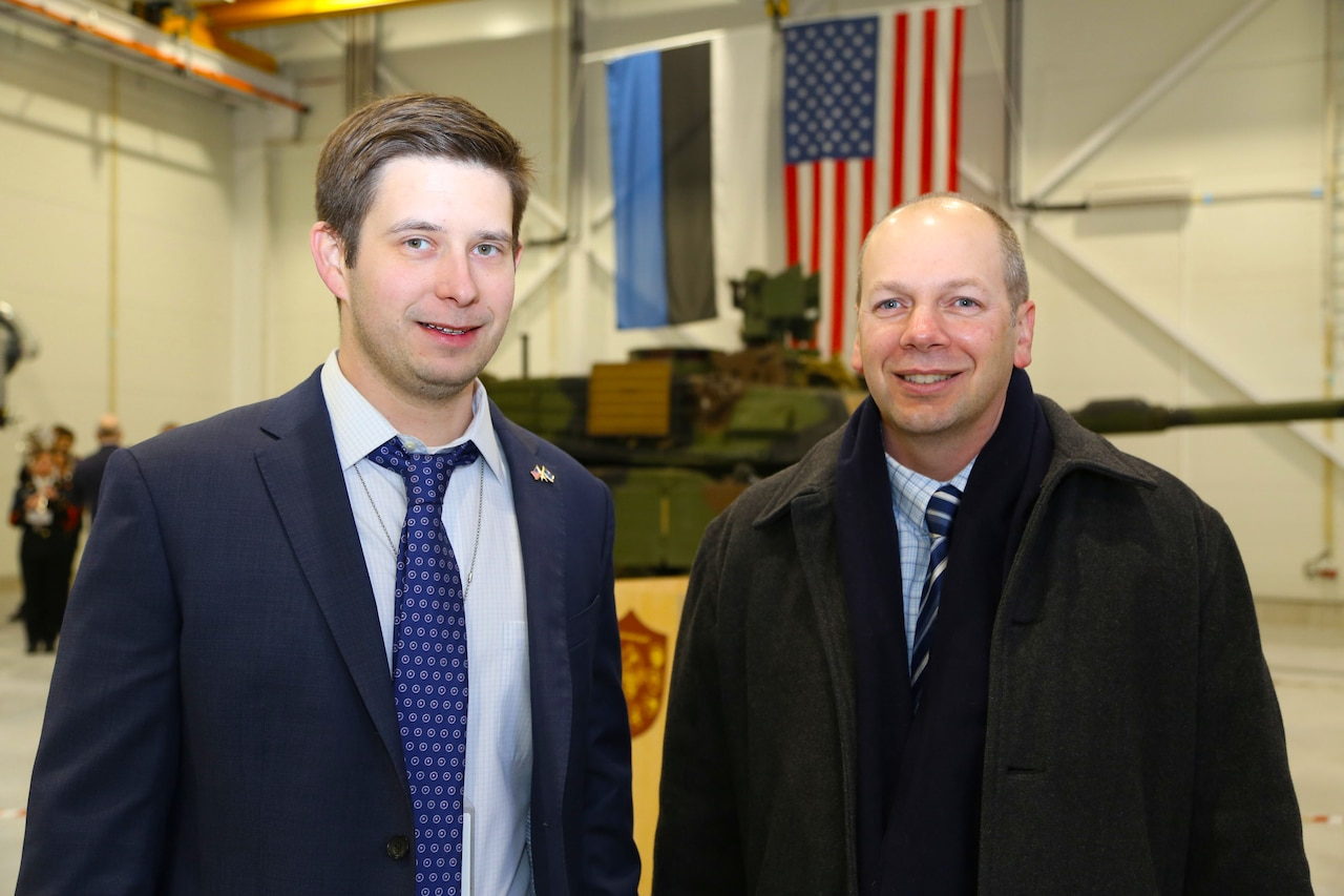 Chris Bailey, left, the U.S. Army Corps of Engineers Europe district project engineer in Estonia, takes part in a ceremony marking the completion of 27 European Reassurance Initiative projects for U.S. Army Europe at Tapa Military Base in Estonia, Dec. 15, 2016. The projects are designed to support training and readiness of NATO, U.S. and Estonian forces. U.S. Army Corps of Engineers Europe photo by Jennifer Aldridge