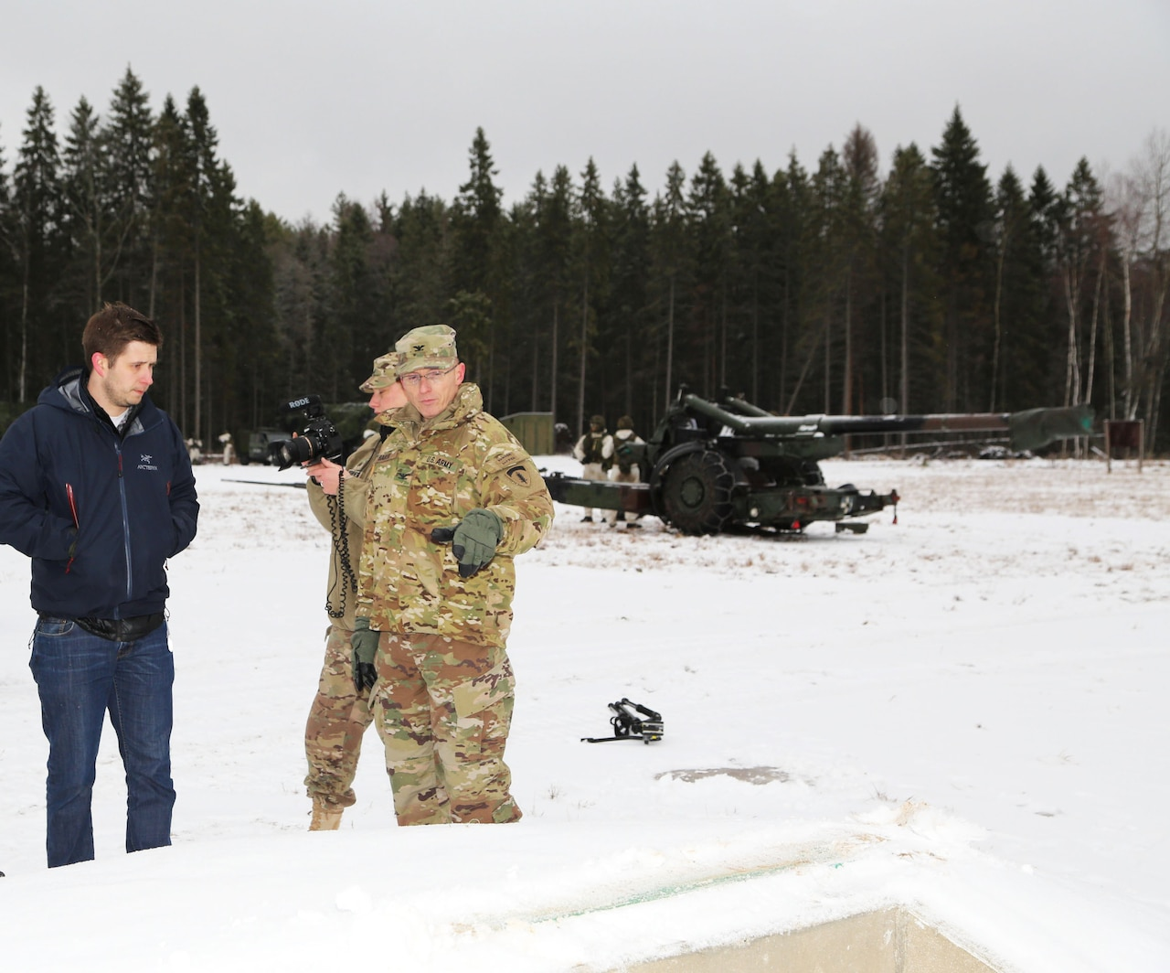 Chris Bailey, left, the U.S. Army Corps of Engineers Europe district project engineer in Estonia, briefs Army Col. John Baker, right, chief engineer for U.S. Army Europe, on newly constructed machine gun and sniper ranges built through the European Reassurance Initiative to enhance readiness of U.S., Estonian and NATO forces at Tapa Training Area, Estonia, Dec. 14, 2016.  U.S. Army Corps of Engineers Europe photo by Jennifer Aldridge