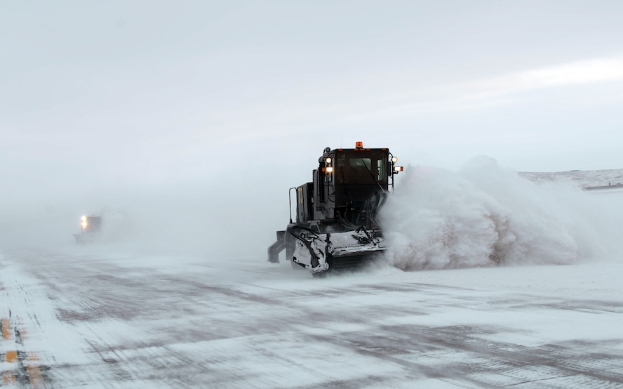 "Personnel from the 28th Civil Engineer Squadron remove snow from the flight line at Ellsworth Air Force Base, S.D., on Jan. 25, 2017. With more than three million square yards of flight line, the civil engineers, also known as ""Dirt Boyz"", have cleared over 20 inches of snow this season alone. (U.S. Air Force photo by Airman 1st Class Donald C. Knechtel)"
