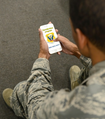 The Text-Me-Now program, which originated at Altus Air Force Base, Oklahoma, and has made its way to Whiteman, makes the process more resourceful and immediate by allowing patients to text message an advocate at the clinic from their mobile device. (U.S. Air Force graphic/Senior Airman Joel Pfiester)
