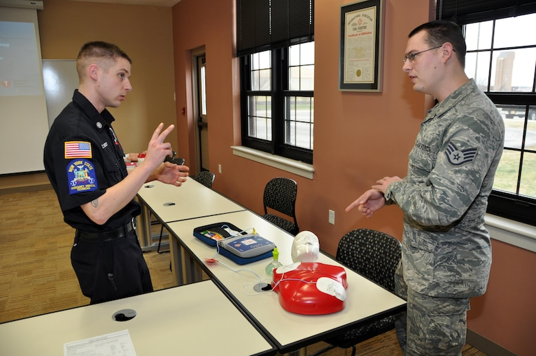 914th Fire Emergency Services Flight firefighter Zachary Weneck instructs Staff Sgt. Keith Partlow, 914th Maintenance Squadron, on the procedure changes to CPR and the Automated External Defibrillator at the Niagara Falls Air Reserve Station, N.Y. January 25, 2017.  Members of the 914th Airlift Wing train continuously to remain current, qualified, and mission ready.  (U.S. Air Force photo by Master Sgt. Kevin Nichols)