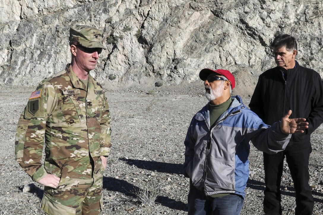 Louis Munoz (center), U.S. Army Corps of Engineers Los Angeles District's dam tender supervisor, discusses Alamo Dam operation with Col. Kirk Gibbs, District commander Jan. 25. The dam provides flood risk reduction, water supply and conservation, recreation, and fish and wildlife enhancement on the Bill Williams River.