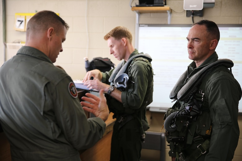 Maj. Gen. John Love, right, 2nd Marine Division commanding general, speaks with Col. John Rahe during a visit to Marine Attack Training Squadron 203, Marine Aircraft Group 14, 2nd Marine Aircraft Wing  aboard Marine Corps Air Station Cherry Point, Jan. 27, 2017. During his visit, Love was able to witness the capabilities of an AV-8B Harrier firsthand as he strapped in and took his first career flight in the aircraft. Love's visit strengthened the relationship between the ground and air combat elements of the Marine Air-Ground Task Force. Rahe is the assistant wing commander for 2nd MAW. (U.S. Marine Corps photo by Lance Cpl. Cody Lemons/Released)