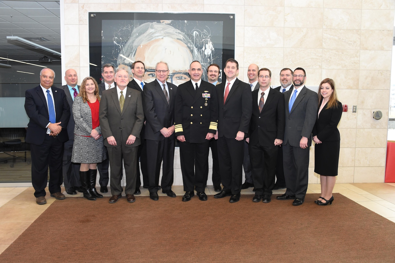"""U.S. Navy Vice Adm. Charles """"Chas"""" A. Richard (center), deputy commander of U.S. Strategic Command (USSTRATCOM); Dr. Hank Bounds (fourth from right), president of University of Nebraska; John Christensen (fourth from left), chancellor of the University of Nebraska at Omaha (UNO); Dr. Lou Pol (third from left), dean of UNO College of Business; and Dr. Hesham H. Ali (left), dean of UNO College of Information Science and Technology, attend the 2017 USSTRATCOM Strategic Leadership Fellows Program kickoff along with fellows program participants at UNO's Mammel Hall, Jan. 20, 2017. The fellows program is designed to develop high-potential civilian leaders in support of USSTRATCOM organizational transformation, broaden mission awareness and develop leadership skills. One of nine DoD unified combatant commands, USSTRATCOM has global strategic missions assigned through the Unified Command Plan that include strategic deterrence; space operations; cyberspace operations; joint electronic warfare; global strike; missile defense; intelligence, surveillance and reconnaissance; and analysis and targeting."""