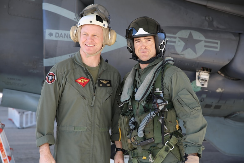 Maj. Gen. John Love, 2nd Marine Division commanding general, stands beside Col. John Rahe, assistant wing commander, in front of an AV-8B Harrier aboard Marine Corps Air Station Cherry Point, Jan. 27, 2017. Love's visit helped strengthen the relationship between the ground and air combat element while witnessing the aircraft's capabilities firsthand. Rahe is the assistant wing commander for 2nd MAW. (U.S. Marine Corps photo by Lance Cpl. Cody Lemons/Released)