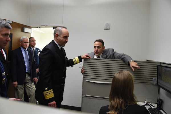 """Dr. Douglas Derrick (right), assistant professor of the University of Nebraska at Omaha (UNO) Information and Technology Innovation School of Interdisciplinary Informatics, explains how UNO's Jack and Stephanie Koraleski Commerce and Applied Behavioral Laboratory equipment works to U.S. Navy Vice Adm. Charles """"Chas"""" A. Richard (center), deputy commander of U.S. Strategic Command, Jan. 20, 2017. Richard and other senior leaders toured UNO's Mammel Hall as part of the 2017 USSTRATCOM Leadership Fellows Program kickoff. One of nine DoD unified combatant commands, USSTRATCOM has global strategic missions assigned through the Unified Command Plan that include strategic deterrence; space operations; cyberspace operations; joint electronic warfare; global strike; missile defense; intelligence, surveillance and reconnaissance; and analysis and targeting."""