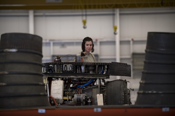 Airman 1st Class Teresa Springer, 23d Component Maintenance Squadron propulsion technician, drops nuts and bolts into a plastic baggie while dissembling a TF-34 engine used in A-10C Thunderbolt lls, Jan. 25, 2017, at Moody Air Force Base, Ga. Airmen from the propulsion flight are responsible for breaking down, refurbishing and repairing TF-34 engines to replace ones currently in use in A-10s. (U.S. Air Force photo by Airman 1st Class Daniel Snider)