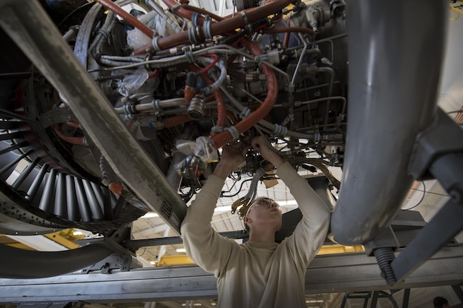 Airman 1st Class Anthony Guevara, 23d Maintenance Squadron (MXS) aerospace propulsion technician, loosens a connection on the underside of a TF34 engine used in A-10C Thunderbolt lls, Jan. 25, 2017, at Moody Air Force Base, Ga. For the first time, in Aug. 2018, the 23d MXS propulsion flight ensured every TF34 engine in their fleet was repaired to serviceable status with zero required maintenance work. While they normally maintain the 74th and 75th Aircraft Maintenance Unit's engines in support of Moody's close-air support mission, the backshop will now centralize their TF34 repair efforts to assist other bases and Major Commands. This has allowed the flight to play a vital role in helping secure an Air Force-wide 200 percent 'war-ready' engine status, the highest in the TF34's 40-year history. (U.S. Air Force photo by Senior Airman Daniel Snider)