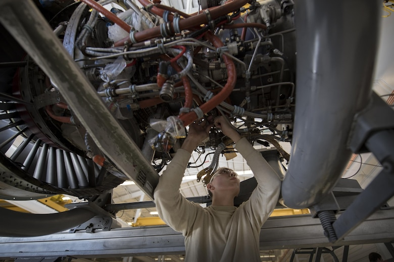 Airman 1st Class Anthony Guevara, 23d Component Maintenance Squadron propulsion technician, loosens a connection on the underside of a TF-34 engine used in A-10C Thunderbolt lls, Jan. 25, 2017, at Moody Air Force Base, Ga. Airmen from the propulsion flight are responsible for breaking down, refurbishing and repairing TF-34 engines to replace ones currently in use in A-10s. (U.S. Air Force photo by Airman 1st Class Daniel Snider)
