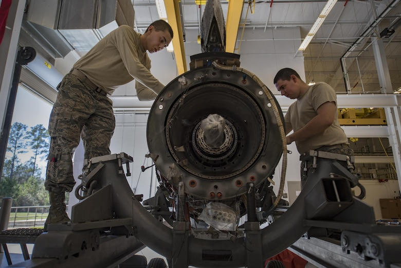 Both 23d Component Maintenance Squadron propulsion technicians, Airman 1st Class Anthony Guevara, left, and Airman 1st Class Jesse Mendheim, disassemble a TF-34 engine used in A-10C Thunderbolt lls, Jan. 25, 2017, at Moody Air Force Base, Ga. Airmen pay close attention to detail while systematically breaking the engine down. (U.S. Air Force photo by Airman 1st Class Daniel Snider)