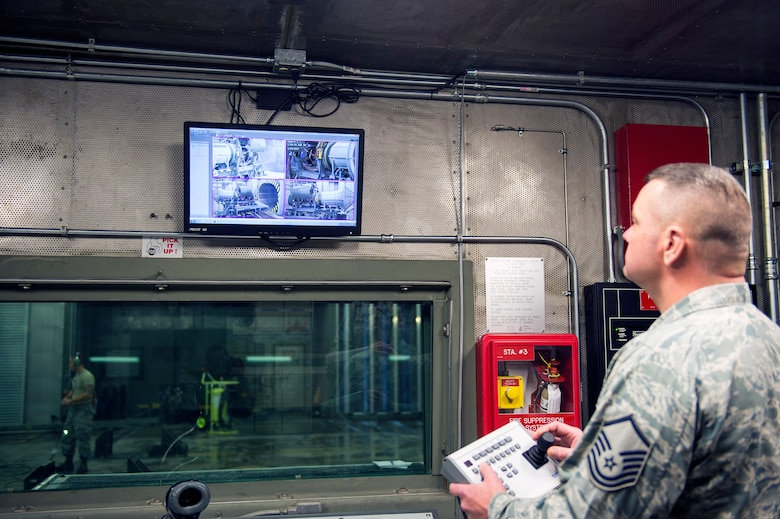 """Master Sgt. Thomas Dobbelaere, 23d Component Maintenance Squadron test cell section chief, navigates the new camera system in the newly upgraded """"Hush House 1,"""" Jan. 23, 2017, at Moody Air Force Base, Ga. The facility belongs to the 23d CMS test cell team. They are responsible for testing the TF-34 engine in an enclosed environment that suppresses the sound of engines while they are tested for serviceability. (U.S. Air Force photo by Airman 1st Class Greg Nash)"""