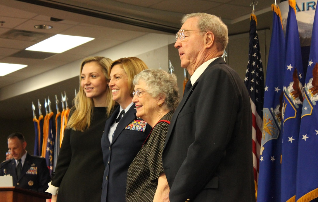 Brig. Gen. Ellen Moore (center), Commander, Air Reserve Personnel Center, stands with her daughter, Maggie, and her parents Sheila and Charley Pritchett during her promotion ceremony Jan. 27, 2017, at Buckley Air Force Base, Colo. Moore is the first female brigadier general to command ARPC. (U.S. Air Force photo by Master Sgt. Beth Anschutz)