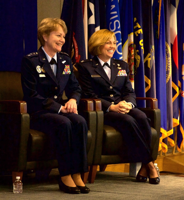 Lt. Gen. Maryanne Miller (left), Chief of Air Force Reserve and Commander, Air Force Reserve Command, and Brig. Gen. Ellen Moore (right), Commander, Air Reserve Personnel Center, smile during Moore's promotion ceremony Jan. 27, 2017, at Buckley Air Force Base, Colo. Moore is the first female brigadier general of ARPC. (U.S. Air Force photo by Master Sgt. Rick Grybos)