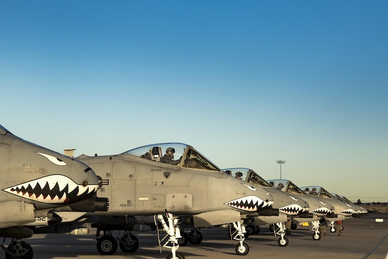 Seven A-10C Thunderbolt II aircraft from the 74th Fighter Squadron line up at the end of the runway for final preparations before take off during Green Flag-West 17-03, Jan. 24, 2017, at Nellis Air Force Base, Nev. The 74th FS brought 12 A-10s to GFW in support of a joint, large-force combat-readiness exercise for close air support integration training. (U.S. Air Force photo by Staff Sgt. Ryan Callaghan)
